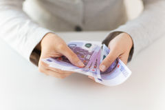 close-up-woman-hands-counting-euro-money-business-finance-saving-banking-people-concept-63064171